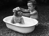 Baby Siblings Taking a Bath