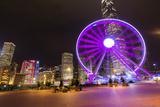 Hong Kong  China Night Skyline with New Ferris Wheel and Twilight   Purple