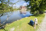 Woman Enjoying the Pond before Castle Egeskov  Denmark