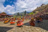 Costumed Dancers at Religious Festivity with Many Visitors  Paro Tsechu  Bhutan