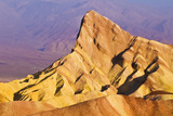 Dawn Light on Manly Beacon from Zabriskie Point  Death Valley National Park California Usa