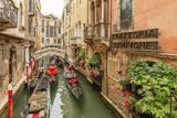 Gondola Traffic in Narrow Canal Venice Italy
