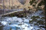 A Long Suspension Bridge over a River on the Fox Glacier Track  Wanaka  South Island  New Zealand