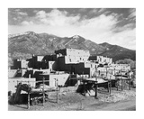 Full view of city  mountains in background  Taos Pueblo National Historic Landmark  New Mexico  194
