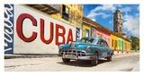 Vintage car and mural  Cuba