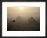 The Vimy flies above fog-shrouded pyramids during a golden sunrise at Giza