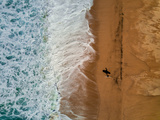 A Surfer and His Shadow as Seen from the Air