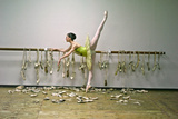 A Ballerina Poses with All the Pointe Shoes She Used in Her Career