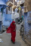 A Woman in a Red Sari Walks Down a Street in Jodhpur's Blue City