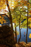 A Fifteen Year Old Paddles His Sup Through Fall Foliage on the Chesapeake and Ohio Canal