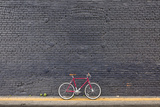 Beverly Hills  Los Angeles  California  USA: A Red Single Speed Bike In Front Of A Black Brick Wall