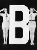 Two Women Saluting with Huge Letter B