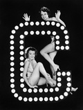 Two Young Women Posing with the Letter C