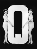 Two Women Pointing at Huge Letter Q