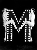 Two Young Women Posing with the Letter M