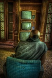 Male Figure in Abandoned Building with Televisions