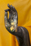 Thailand Buddha Statue hand with gold leaf tokens