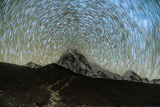 Star trails over Pumori Peak in the Himalayas  Nepal hiking to Everest Base Camp from Gorak Shep