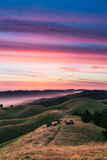 Colorful sunset with pink clouds on Mt Tam in San Francisco with rolling  golden hills