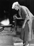 Woman Weighing Silver Outside Foundry