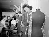 Mrs Ryie Yoshizawa teaching a dressmaking class to women students at Manzanar  1943