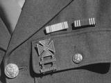 Service ribbons and qualification badge above pocket of military uniform worn by Jimmie Shohara