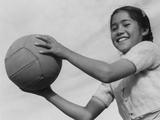 Girl with volley ball  Manzanar Relocation Center  1943