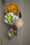 Street vendor with baskets of fruit on bicycle  Old Quarter  Hanoi  Vietnam