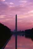 Washington Monument mirrored in the Reflecting Pool at twilight