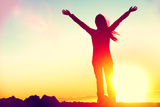 Happy Celebrating Winning Success Woman at Sunset or Sunrise Standing Elated with Arms Raised up Ab