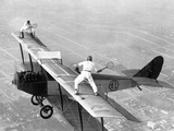 Daredevils Playing Tennis on a Biplane