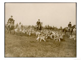 The Chase of the Devon and Somerset Stag Hunt with Horses and Hounds Running Downhill England