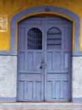 A Smokey Grey Wooden Door of a Painted Colonial House  Granada Granada  Nicaragua