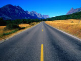 Road with Mountain Range in Distance Glacier National Park  Montana  USA