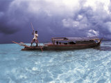 Bajau Fisherman in Traditional Lepa Boat with Rain Clouds Behind  Pulau Gaya  Borneo  Malaysia
