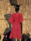Back View of a Nuer Woman Carrying a Wicker Cradle or Crib on Her Head, Ilubador State, Ethiopia Papier Photo par Bruno Barbier