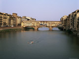 Skiff on the River Arno and the Ponte Vecchio  Florence  Tuscany  Italy