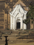 Silhouette of a Woman with Tray on Her Head Walking Past Stupa Entrance  Near Mandalay  Myanmar