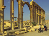 Two Cyclists Pass the Great Colonnade (Cardo)  Palmyra  Unesco World Heritage Site  Syria