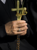 A Nun's Hands Holding Two Crosses Made of Palm Leaves  St Anne Church  Israel