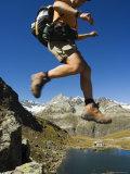 Hiker Running on Trail Above Lake at Schwarzee Paradise  Zermatt Alpine Resort  Valais  Switzerland