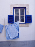 Laundry Hanging on Line at Window in the Moorish Quarter of Alfama  Lisbon  Portugal
