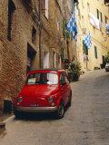 Red Car Parked in Narrow Street  Siena  Tuscany  Italy