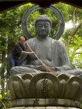 Man Cleaning a Buddha Statue  Shinnyo-Do Temple  Kyoto  Kinki  Japan