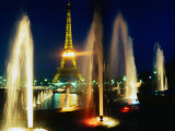 The Eiffel Tower at Night with Fountains in the Foreground  Paris  France