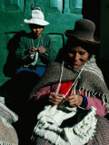 Women in Hats  Knitting Outside in the Sunshine  by a Green Wooden Door  Peru