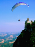 Person Hang-Gliding over Castle with Countryside Beyond  San Marino  San Marino