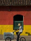 Ice Cream Vendor Riding Bicycle Past Colourful House  Granada  Nicaragua