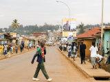 Man Crossing Road and People on Footpath  Kigali  Rwanda