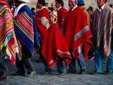 Young Boy and Several Men in Ponchos in the Corpus Christi Procession  Cuzco  Peru